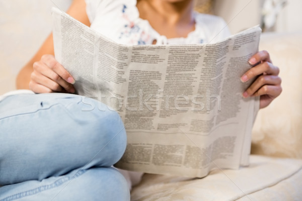 Mid section of woman reading newspaper Stock photo © wavebreak_media