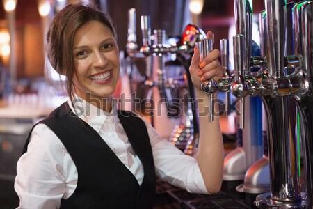 Portrait of woman having a glass of wine Stock photo © wavebreak_media