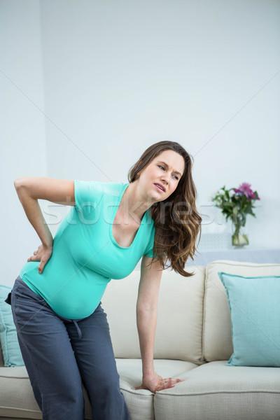 Mulher grávida dor nas costas sala de estar mulher casa saúde Foto stock © wavebreak_media