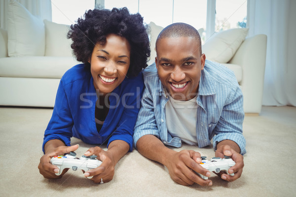 Smiling couple lying on the floor Stock photo © wavebreak_media