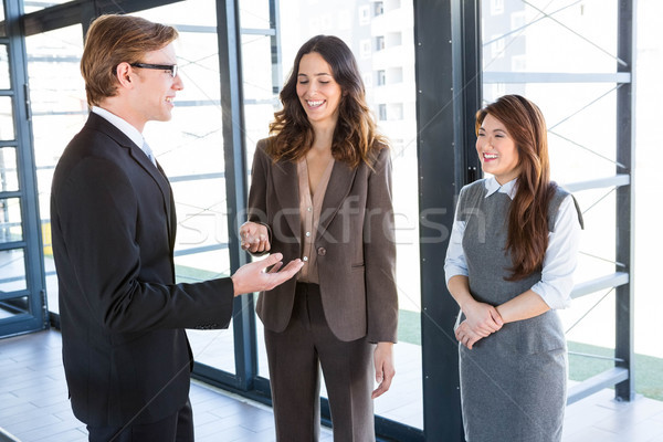 Three colleagues discussing in office  Stock photo © wavebreak_media