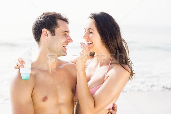 Felice donna naso spiaggia Foto d'archivio © wavebreak_media