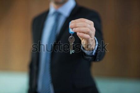 Agent immobilier clé Resort affaires homme Photo stock © wavebreak_media