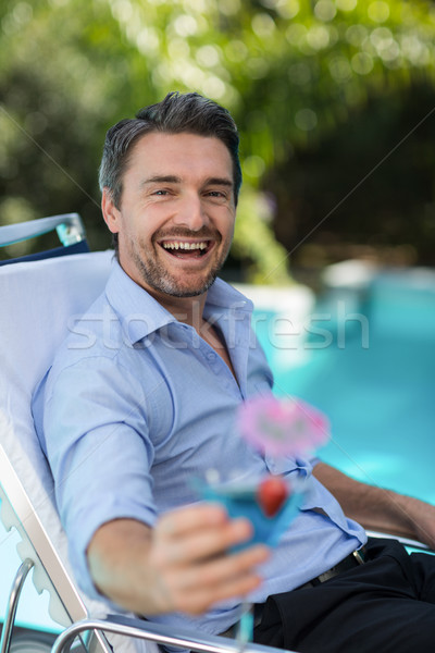 Inteligente homem martini glass relaxante sol Foto stock © wavebreak_media