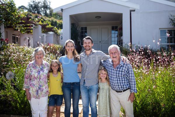 Multi-generation family standing on the garden path Stock photo © wavebreak_media