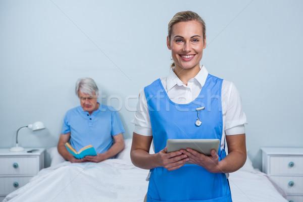 Smiling nurse holding digital tablet at hospital Stock photo © wavebreak_media