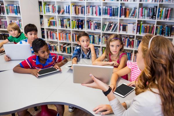 Genç güzel öğretmen ders çocuklar tablo Stok fotoğraf © wavebreak_media