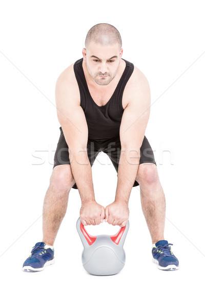 Testépítő emel nehéz kettlebell fehér férfi Stock fotó © wavebreak_media