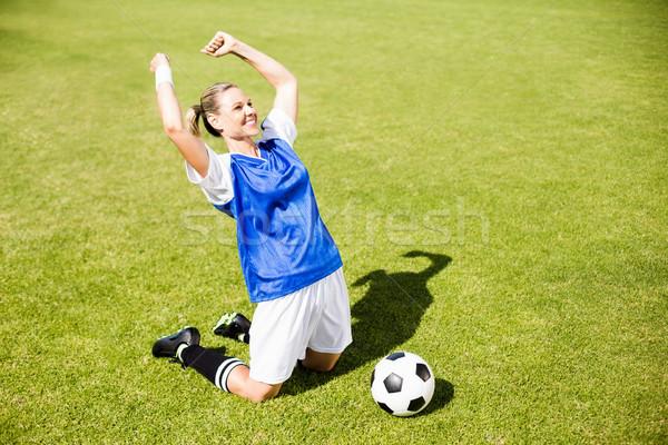 Excited football player kneeling in stadium Stock photo © wavebreak_media