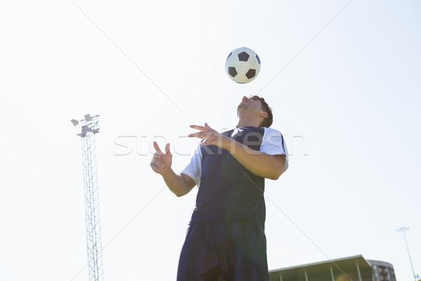 Futballista gyakorol futball stadion férfi képzés Stock fotó © wavebreak_media