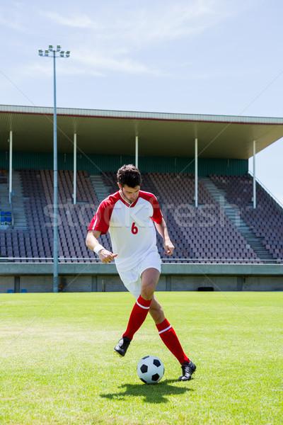 Futballista gyakorol futball stadion férfi futball Stock fotó © wavebreak_media