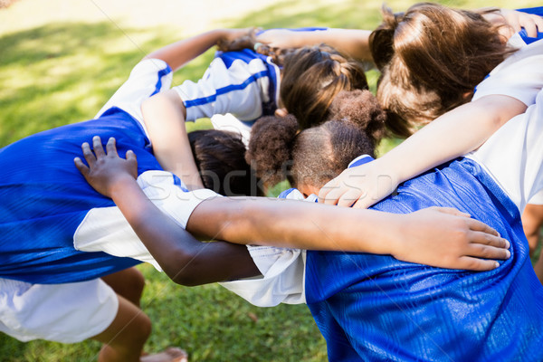 Overhead view of soccer team forming huddle  Stock photo © wavebreak_media