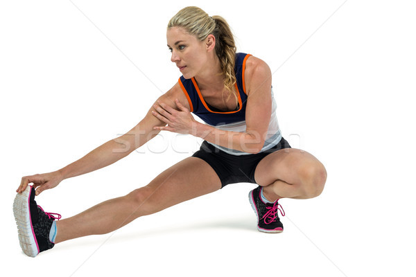 Athletic woman stretching her hamstring Stock photo © wavebreak_media