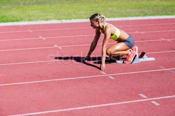 Female athlete ready to run on running track Stock photo © wavebreak_media