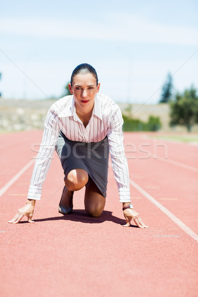 Businesswoman in ready to run position Stock photo © wavebreak_media