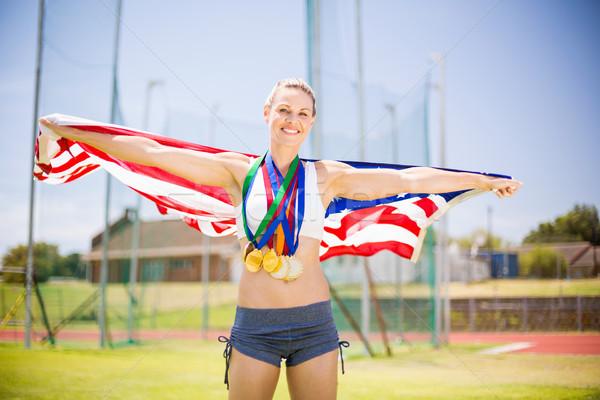 Portret vrouwelijke atleet Amerikaanse vlag goud Stockfoto © wavebreak_media