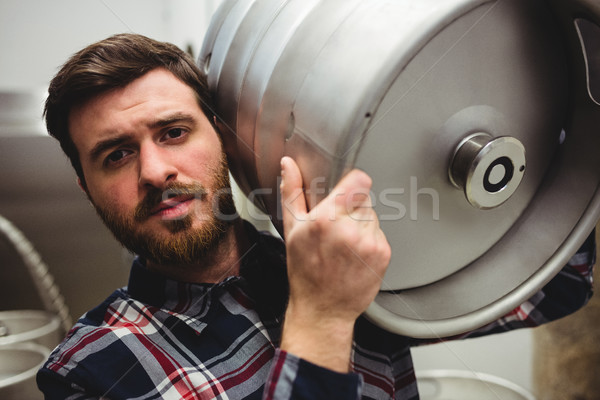 Young manufacturer carrying keg in brewery Stock photo © wavebreak_media
