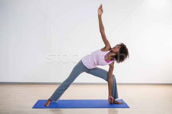 Woman performing yoga Stock photo © wavebreak_media