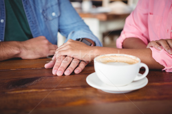 Mid-section of couple holding hands Stock photo © wavebreak_media