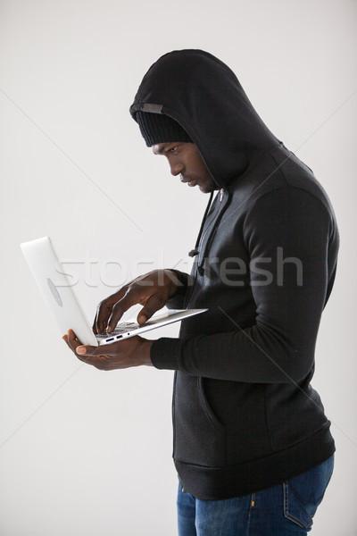 хакер используя ноутбук белый компьютер ноутбук весело Сток-фото © wavebreak_media