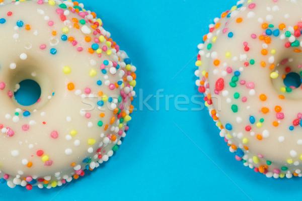 Close-up of tasty doughnuts with sprinkles Stock photo © wavebreak_media