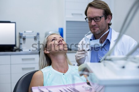 Doctor checking medical report of patient Stock photo © wavebreak_media