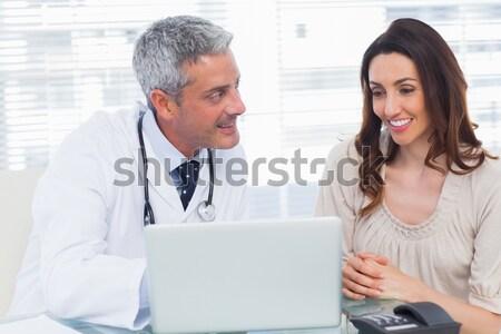 Doctor assisting female patient on digital tablet Stock photo © wavebreak_media