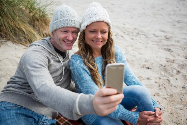 Happy couple taking a selfie from mobile phone Stock photo © wavebreak_media