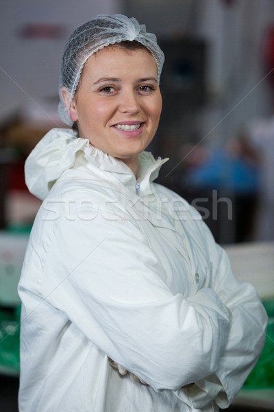 Female butcher standing with arms crossed Stock photo © wavebreak_media