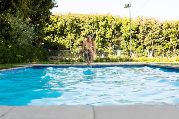 Young woman jumping in the pool Stock photo © wavebreak_media