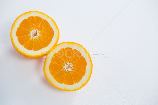 Ripe tasty orange cut into two halves Stock photo © wavebreak_media