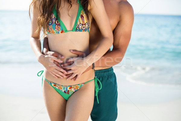 Man embracing girlfriend standing on shore Stock photo © wavebreak_media
