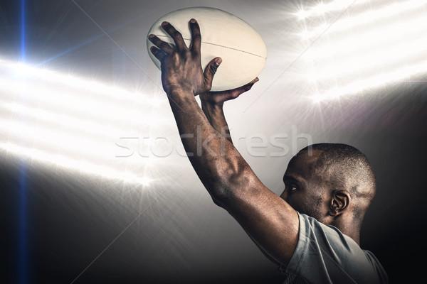 összetett kép atléta dob rögbilabda reflektor Stock fotó © wavebreak_media