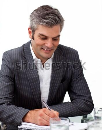 Assertive mature businessman studying a document  Stock photo © wavebreak_media