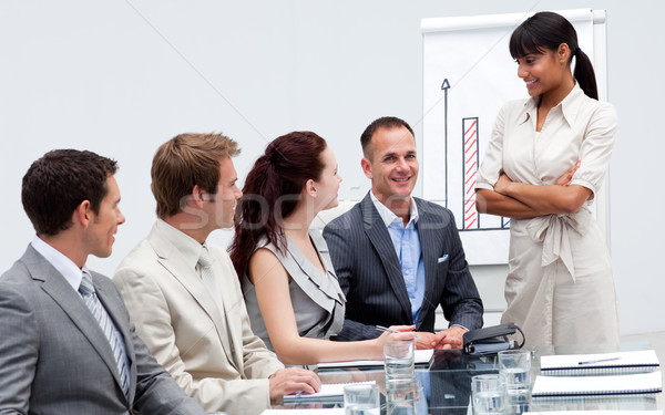 Stock photo: Smiling businessman in a presentation