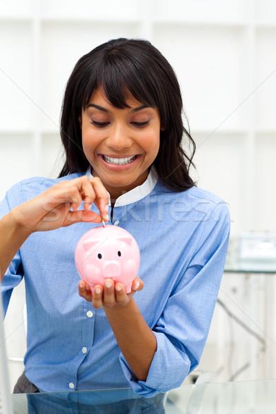 Entuzjastyczny etnicznych kobieta interesu oszczędność ceny skarbonka Zdjęcia stock © wavebreak_media