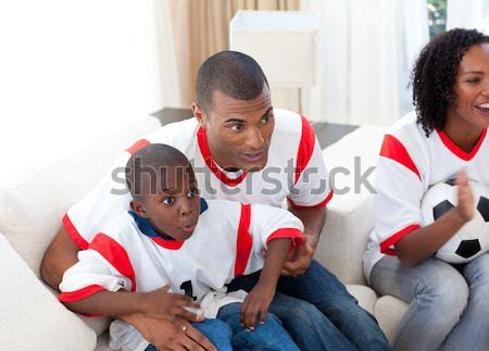 Feliz hijo de padre objetivo sofá mujer Foto stock © wavebreak_media