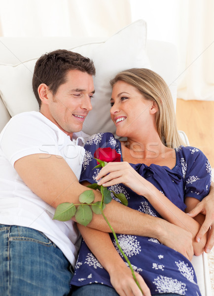 Enamored lovers relaxing on sofa Stock photo © wavebreak_media