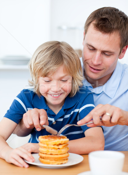Attentive father and his son eating waffles Stock photo © wavebreak_media