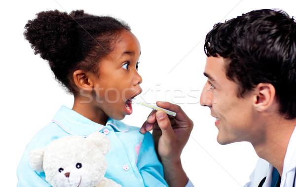 Assertive doctor taking his patient's temperature  Stock photo © wavebreak_media