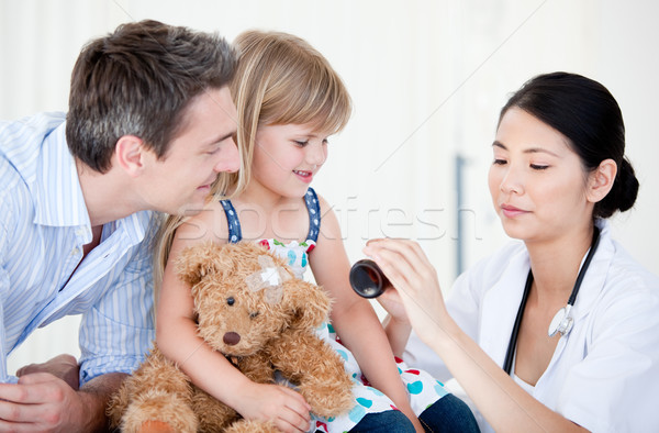 Confident female doctor giving syrup to a little girl  Stock photo © wavebreak_media