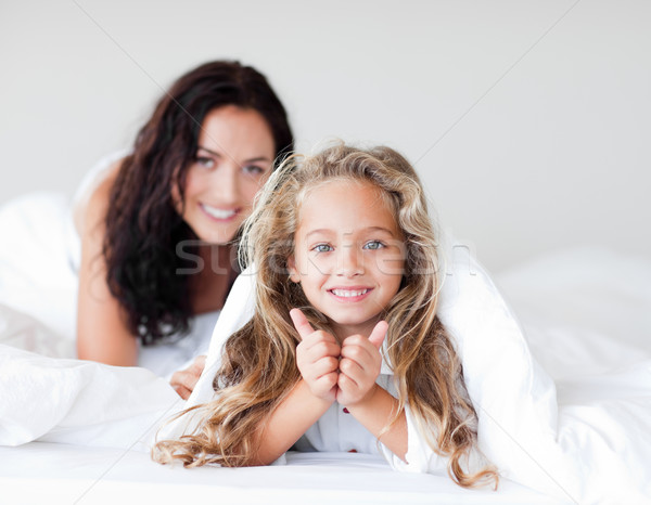 Attractive mother and daugther embracing on bed Stock photo © wavebreak_media