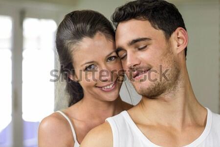 Ritratto affettuoso uomo bacio moglie bianco Foto d'archivio © wavebreak_media