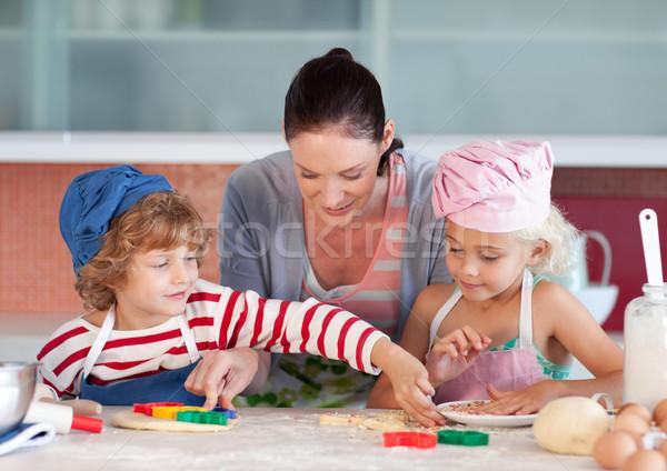 Smiling mother baking with her children Stock photo © wavebreak_media