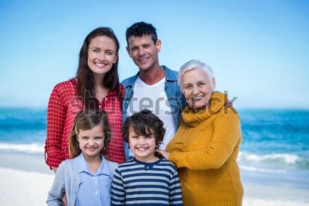 Pais crianças piggyback família sorrir grama Foto stock © wavebreak_media
