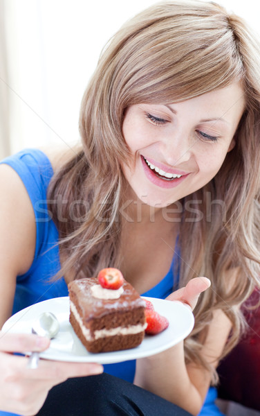 Happy woman holding a piece of chocolate cake Stock photo © wavebreak_media