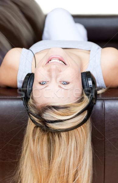 Aantrekkelijke vrouw hoofdtelefoon sofa gelukkig rock leuk Stockfoto © wavebreak_media
