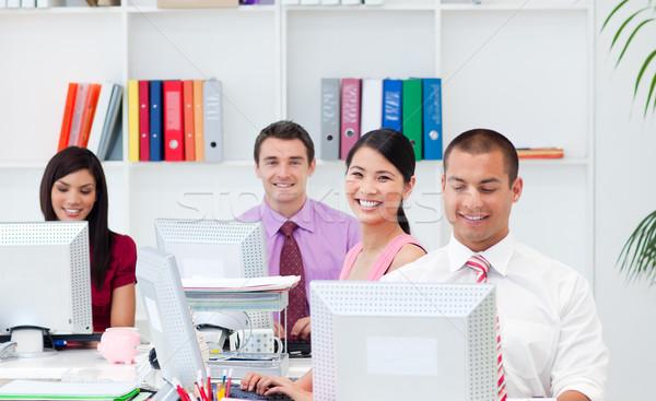 положительный деловые люди рабочих компьютеры служба компьютер Сток-фото © wavebreak_media