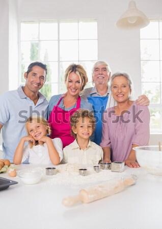 Grandparents, parents and children baking in the kitchen Stock photo © wavebreak_media