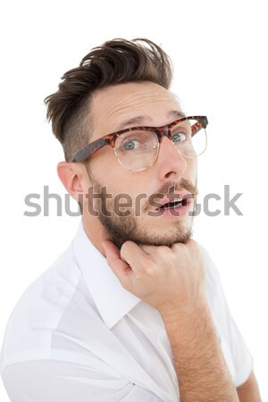 Positive man looking into the camera on a white background  Stock photo © wavebreak_media